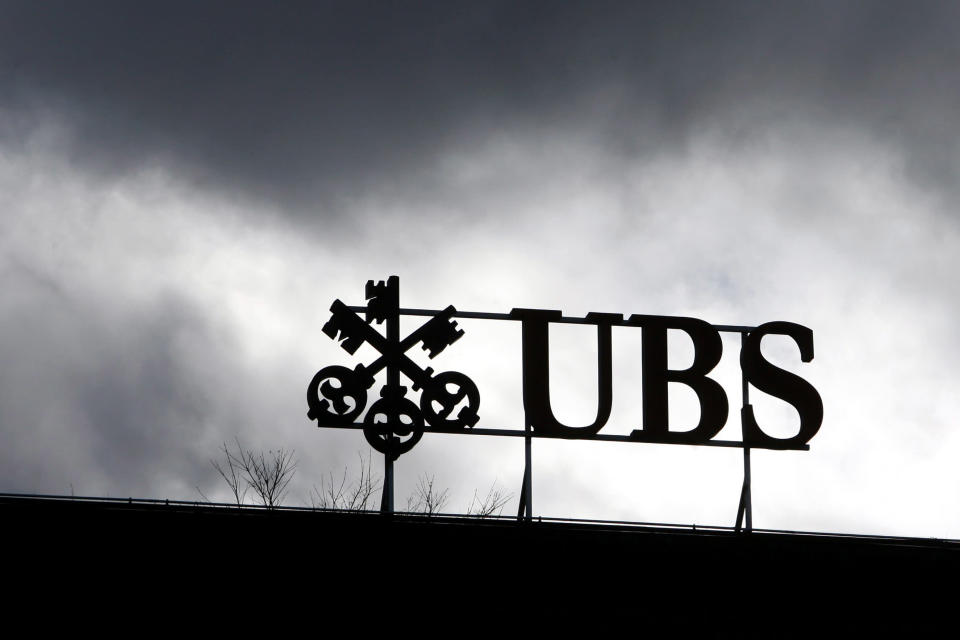 FILE - In this Aug. 9, 2012 file photo the logo of Swiss UBS bank is pictured under dark clouds in Zurich, Switzerland. The European Commission has fined a group of major global banks a total of 1.7 billion euros (US dollar 2.3 billion) for colluding to profit from the interest rates market as it was announced Wednesday, Dec. 4, 2013. The banks, which includes UBS bank are accused of manipulating for years European and Japanese benchmark interest rates that affect hundreds of billions of dollars in contracts globally, from mortgages to credit card bills. (AP Photo/Keystone, Alessandro Della Bella, File)