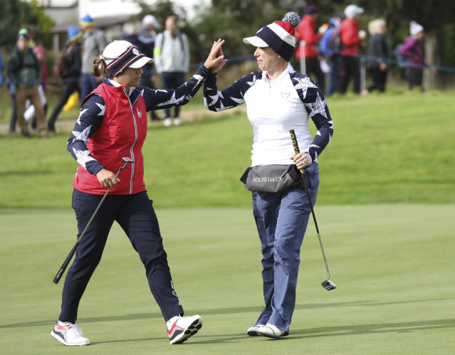 Morgan Pressel, right, and Marina Alex of the U.S celebrate after winning the 12th hole during their Foursomes match against Europe in the Solheim Cup at Gleneagles, Auchterarder, Scotland, Saturday, Sept. 14, 2019. (AP Photo/Peter Morrison)