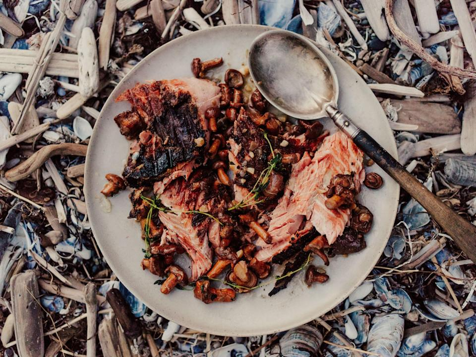"<a href=""https://www.bonappetit.com/recipe/whole-grilled-salmon-with-chanterelles?mbid=synd_yahoo_rss"" rel=""nofollow noopener"" target=""_blank"" data-ylk=""slk:See recipe."" class=""link rapid-noclick-resp"">See recipe.</a>"