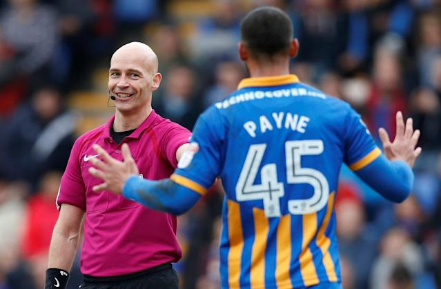 "Soccer Football - League One - Shrewsbury Town vs AFC Wimbledon - Montgomery Waters Meadow, Shrewsbury, Britain - March 24, 2018 Shrewsbury Town's Stefan Payne makes an appeal for a penalty to referee Darren Drysdale Action Images/Ed Sykes EDITORIAL USE ONLY. No use with unauthorized audio, video, data, fixture lists, club/league logos or ""live"" services. Online in-match use limited to 75 images, no video emulation. No use in betting, games or single club/league/player publications. Please contact your account representative for further details."
