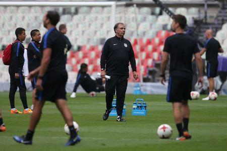 FILE PHOTO: Football Soccer - U.S. national soccer team training - World Cup 2018 Qualifiers in Mexico City - 10/6/17- U.S. national soccer team coach Bruce Arena attends a training session. REUTERS/Edgard Garrido