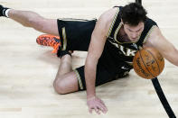 Atlanta Hawks forward Danilo Gallinari (8) falls to the floor after being fouled in the first half of an NBA basketball game against the Boston Celtics Wednesday, Feb. 24, 2021, in Atlanta. (AP Photo/John Bazemore)