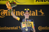 Stage winner Sepp Kuss of the US celebrates on the podium after the fifteenth stage of the Tour de France cycling race over 191.3 kilometers (118.9 miles) with start in Ceret and finish in Andorra-la-Vella, Andorra, Sunday, July 11, 2021. (AP Photo/Christophe Ena)