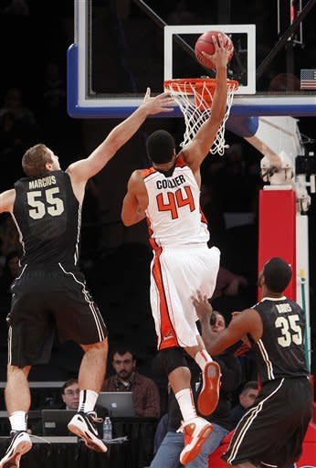 Oregon State's Devon Collier (44) dunks the ball over Purdue's Sandi Marcius (55) and Rapheal Davis (35) during the first half of their NCAA college basketball game in the consolation round of the 2K Sports Classic at Madison Square Garden, Friday, Nov. 16, 2012, in New York. (AP Photo/Jason DeCrow)