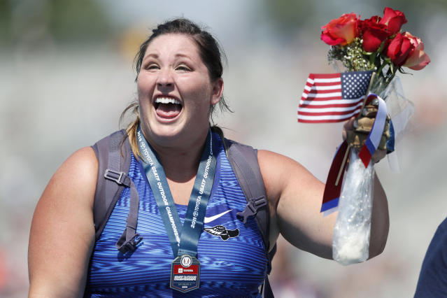 DeAnna Price reacts to the crowd after receiving her medal for winning the women's hammer throw at the U.S. Championships athletics meet, Saturday, July 27, 2019, in Des Moines, Iowa. (AP Photo/Charlie Neibergall)