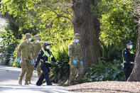 Australian Defence Force staff (ADF) and Victorian police are seen on patrol as a lockdown of Melbourne forces people to stay at home if not working due to the continuing spread of COVID-19, Wednesday, Aug. 5, 2020. Victoria state, Australia's coronavirus hot spot, announced on Monday that businesses will be closed and scaled down in a bid to curb the spread of the virus. (AP Photo/Asanka Brendon Ratnayake)