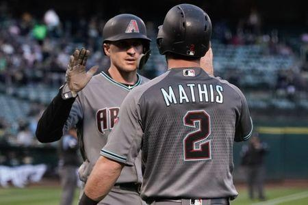 May 25, 2018; Oakland, CA, USA; Arizona Diamondbacks shortstop Nick Ahmed (13) celebrates with catcher Jeff Mathis (2) against the Oakland Athletics during the fourth inning at Oakland Coliseum. Mandatory Credit: Stan Szeto-USA TODAY Sports