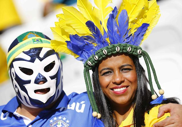 Brazilian fans poss before the 2014 World Cup opening match between Brazil and Croatia at the Corinthians arena in Sai Paulo June 12,2014. REUTERS/Kai Pfaffenbach (BRAZIL - Tags: SOCCER SPORT WORLD CUP)