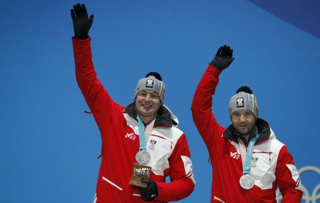 Medals Ceremony - Luge - Pyeongchang 2018 Winter Olympics - Men's Doubles - Medals Plaza - Pyeongchang, South Korea - February 16, 2018 - Silver medalists Peter Penz and Georg Fischler of Austria on the podium. REUTERS/Eric Gaillard
