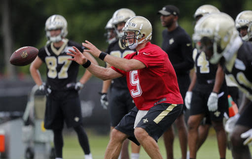 New Orleans Saints quarterback Drew Brees (9) goes through drills during an NFL football practice in Metairie, La., Tuesday, June 12, 2018. (AP Photo/Gerald Herbert)