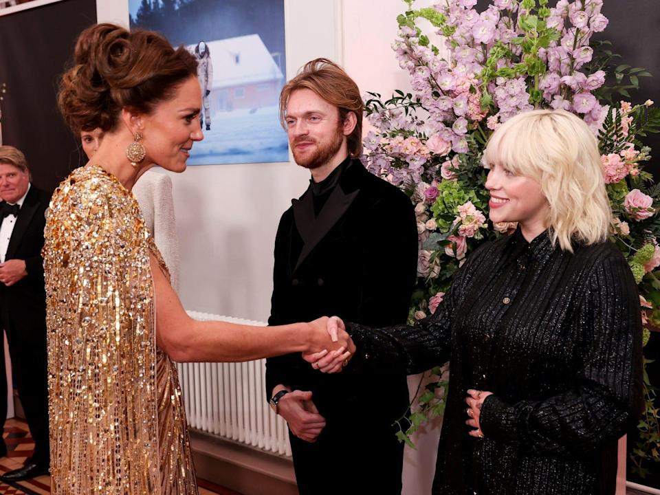 """Kate Middleton and Billie Eilish meet at the """"No Time to Die"""" premiere."""