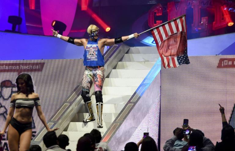 US wrestler Sam Adonis goads the Mexican crowd in his role as a Donald Trump rabble-rouser
