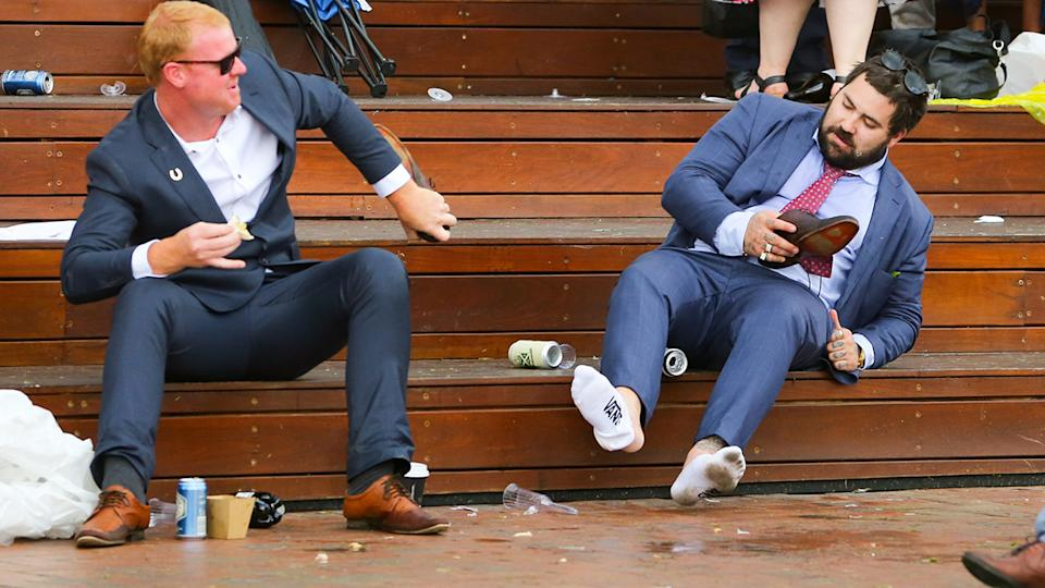 A drunk punter, pictured here at Melbourne Cup day in 2018.