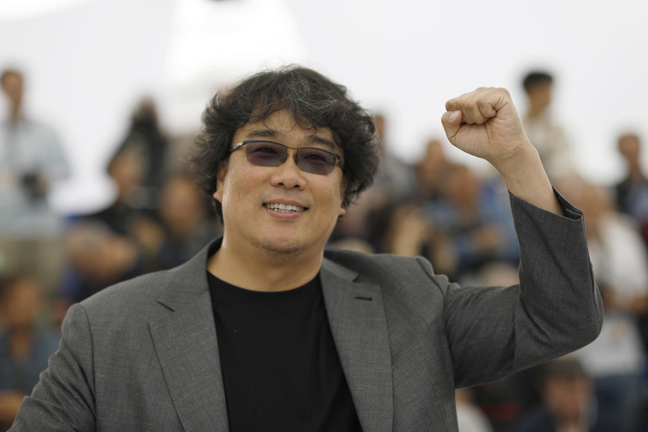 Director Bong Joon-ho poses for photographers at the photo call for the film 'Parasite' at the 72nd international film festival, Cannes, southern France, Wednesday, May 22, 2019. (AP Photo/Petros Giannakouris)