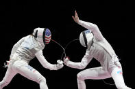 Inna Deriglazova of the Russian Olympic Committee, right, and Lee Kiefer of the United States compete in the women's individual Foil final competition at the 2020 Summer Olympics, Sunday, July 25, 2021, in Chiba, Japan. (AP Photo/Hassan Ammar)