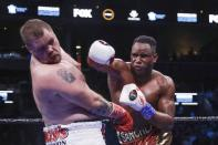 Cuba's Fank Sanchez, right, punches Joey Dawejko during the seventh round of a NABO heavyweight championship boxing match Saturday, March 7, 2020, in New York. Sanchez won the fight. (AP Photo/Frank Franklin II)