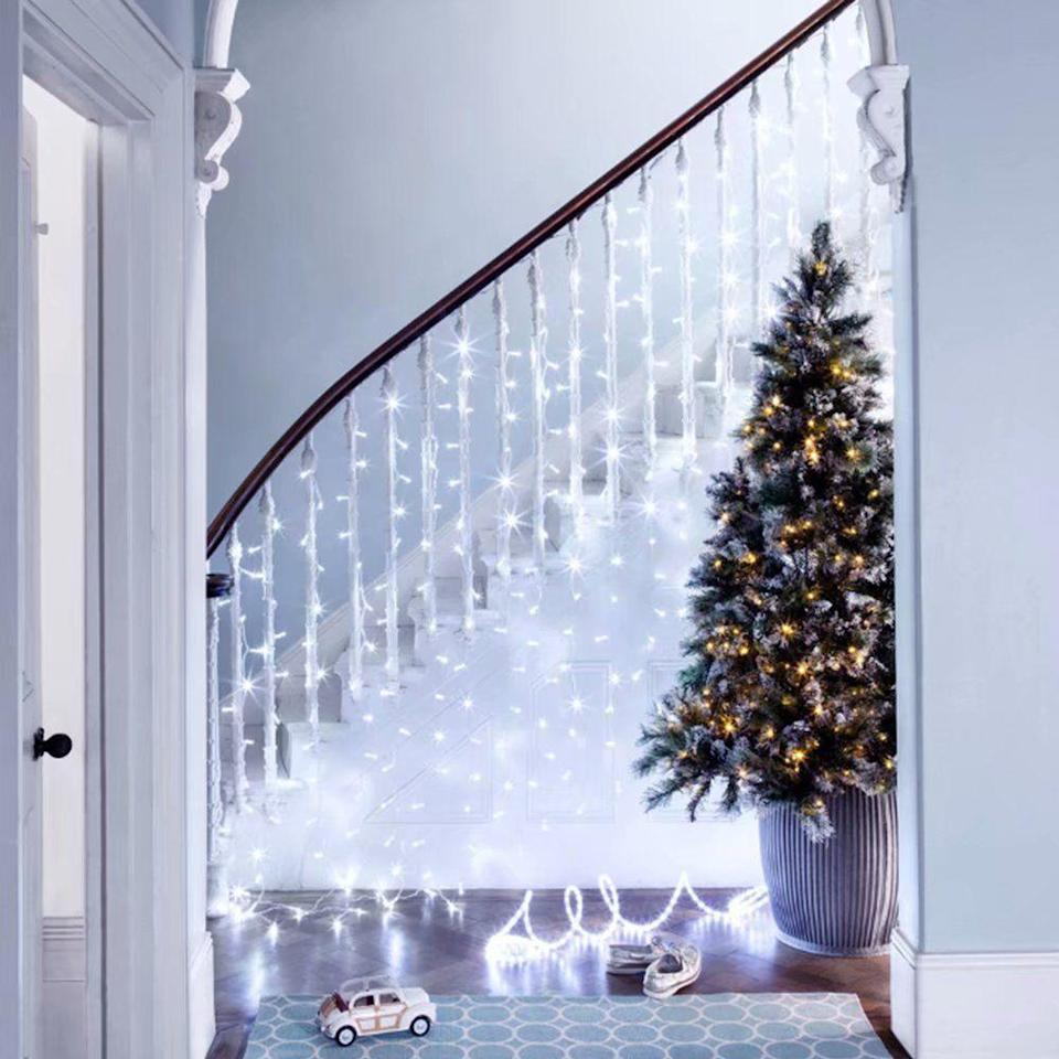 <p>A waterfall of lights lining your staircase makes for a dreamy backdrop to the rest of your holiday decor.</p>