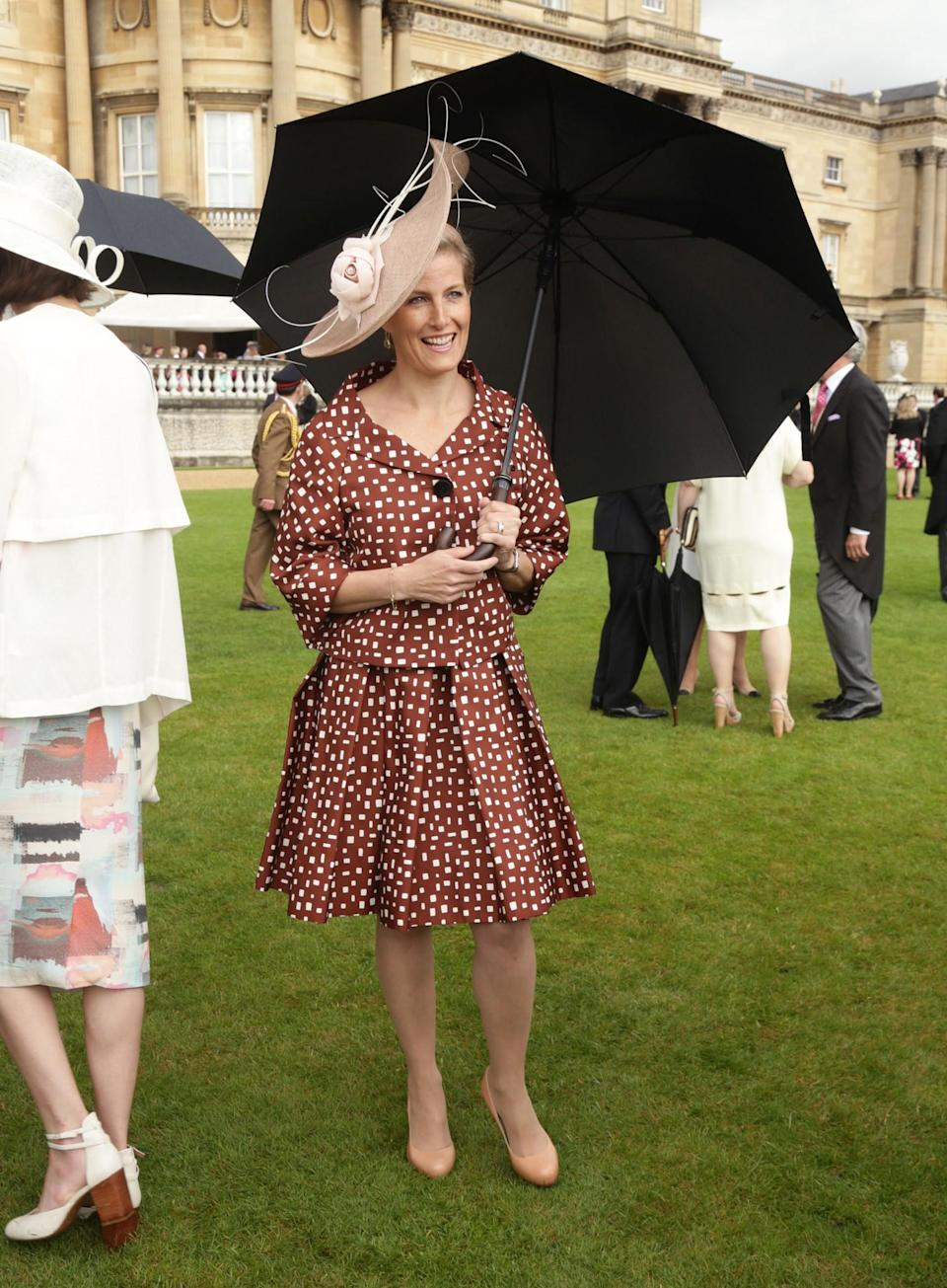 <p>Matching a bold print with nude court shoes in the summer of 2014 [Photo: PA] </p>