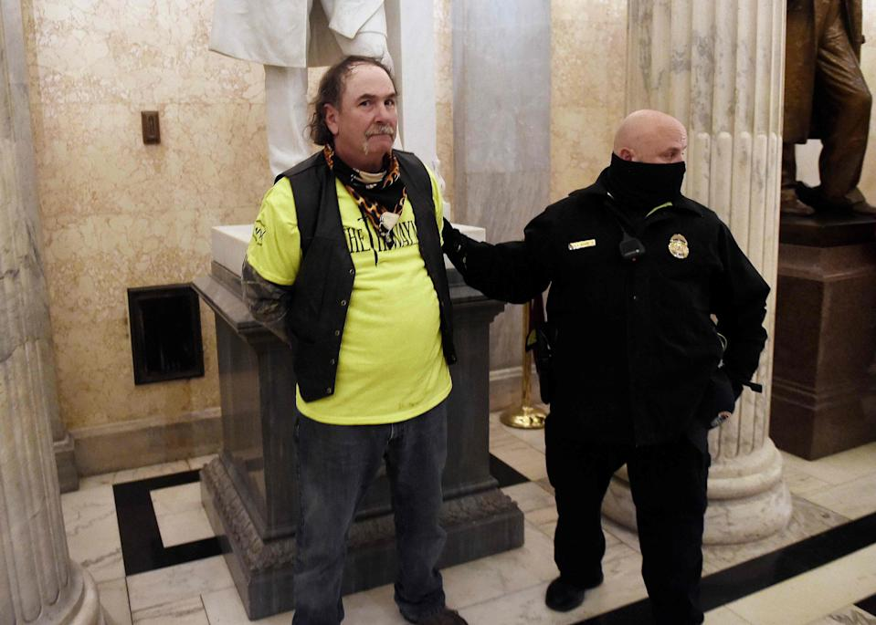 A supporter of President Trump is arrested inside the US Capitol after rioters rushed the building on Jan. 6.