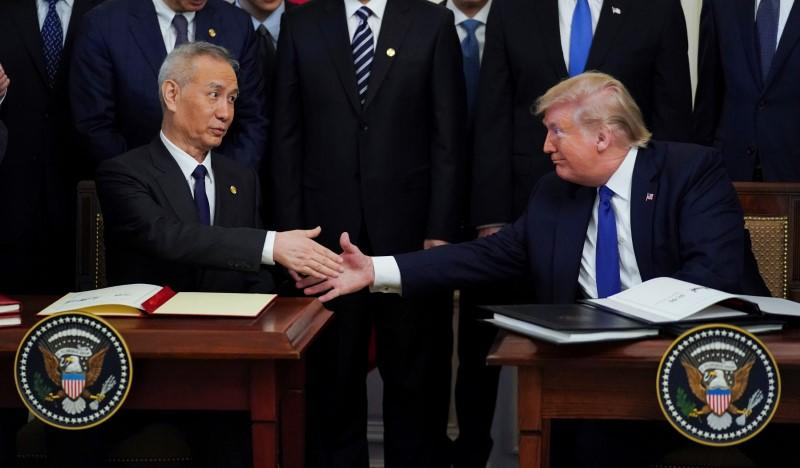 "Chinese Vice Premier Liu He and U.S. President Donald Trump shake hands after signing ""phase one"" of the U.S.-China trade agreement at the White House in Washington"