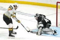 Vegas Golden Knights center Chandler Stephenson, left, tries to get a shot past Los Angeles Kings goaltender Calvin Petersen during the first period of an NHL hockey game Monday, April 12, 2021, in Los Angeles. (AP Photo/Mark J. Terrill)