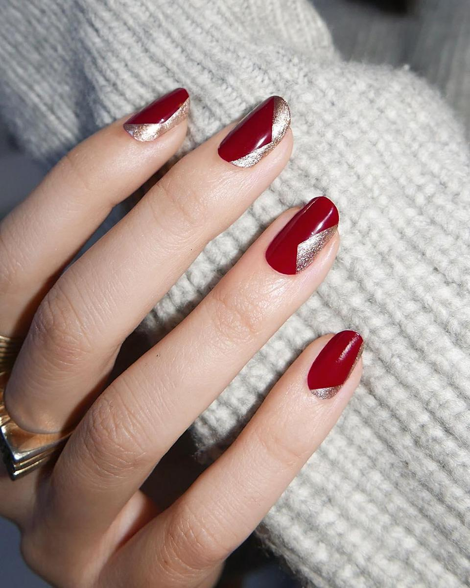 Playing with negative space is a sophisticated take on fun nails for the holidays, while red and gold is a classic Christmas color combo.