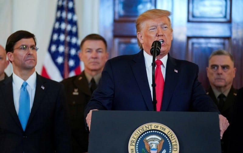 FILE PHOTO: U.S. President Donald Trump delivers a statement about Iran flanked by U.S. Defense Secretary Mark Esper, Army Chief of Staff General James McConville and Chairman of the Joint Chiefs of Staff Army General Mark Milley in the Grand Foyer at the White House in Washington, U.S., January 8, 2020. REUTERS/Kevin Lamarque