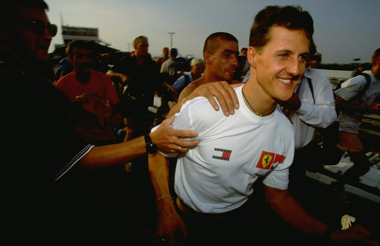 14-16 Aug 1998:  Ferrari driver Michael Schumacher of Germany is congratulated on his win in the Hungarian Grand Prix at the Hungaroring in Budapest, Hungary. \ Mandatory Credit: Mike  Cooper/Allsport