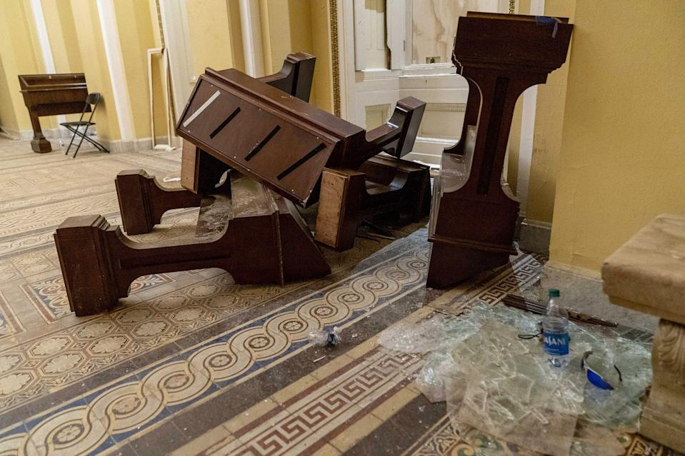 "<p>Damage was visible in the hallways of the U.S. Capitol building in the early morning hours of Jan. 7, after pro-Trump rioters <a href=""https://people.com/politics/dc-protest-photos-us-capitol-pro-trump-riots/?slide=d0e5e02c-e40f-40f9-9d05-7e3641f3959c#d0e5e02c-e40f-40f9-9d05-7e3641f3959c"" rel=""nofollow noopener"" target=""_blank"" data-ylk=""slk:broke through security fencing"" class=""link rapid-noclick-resp"">broke through security fencing</a> outside of the U.S. Capitol and <a href=""https://people.com/politics/trump-protesters-storm-capitol-senate-adjourns/"" rel=""nofollow noopener"" target=""_blank"" data-ylk=""slk:entered the building"" class=""link rapid-noclick-resp"">entered the building</a> as Congress met to certify the votes of the Electoral College.</p>"