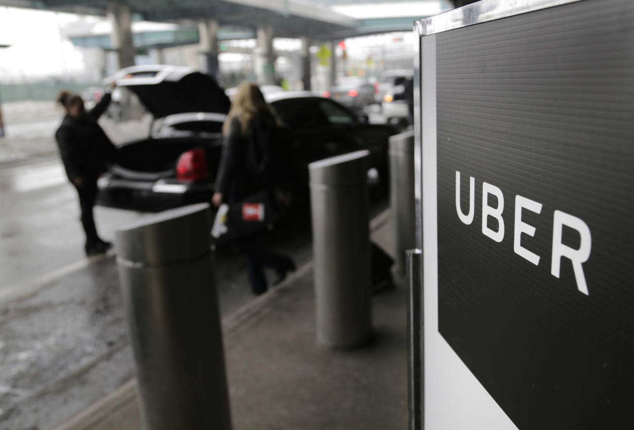 "FILE - In this March 15, 2017, file photo, a sign marks a pick-up point for the Uber car service at LaGuardia Airport in New York. Travis Kalanick, the combative and embattled CEO of ride-hailing giant Uber, resigned under pressure from investors at a pivotal time for the company. Uber's board confirmed the move early Wednesday, June 21, saying in a statement that Kalanick is taking time to heal from the death of his mother in a boating accident ""while giving the company room to fully embrace this new chapter in Uber's history."" (AP Photo/Seth Wenig, File)"