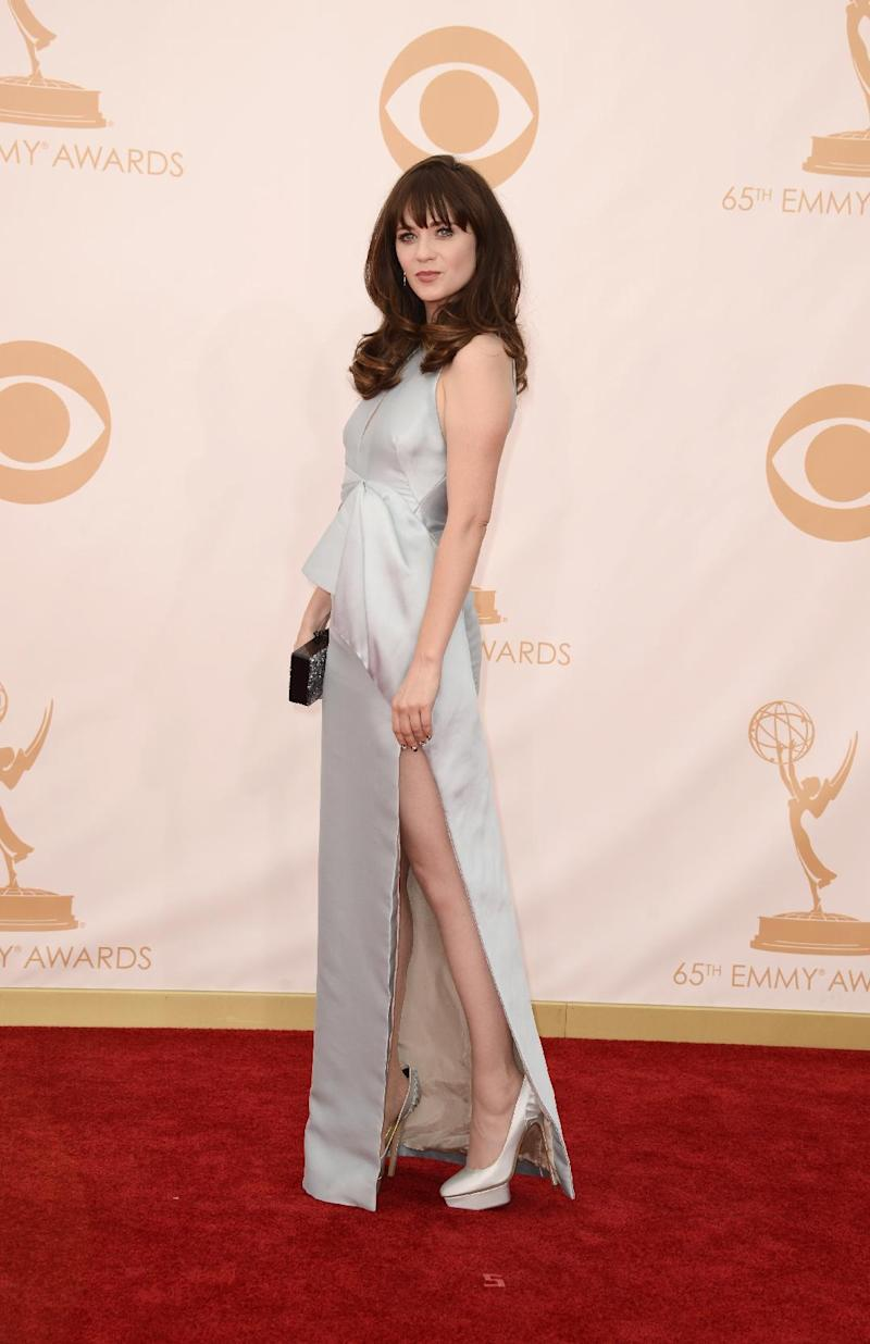 Zooey Deschanel, wearing J. Mendel, arrives at the 65th Primetime Emmy Awards at Nokia Theatre on Sunday Sept. 22, 2013, in Los Angeles. (Photo by Dan Steinberg/Invision/AP)