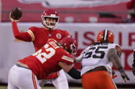 Kansas City Chiefs quarterback Chad Henne throws a pass during the second half of an NFL divisional round football game against the Cleveland Browns, Sunday, Jan. 17, 2021, in Kansas City. (AP Photo/Charlie Riedel)