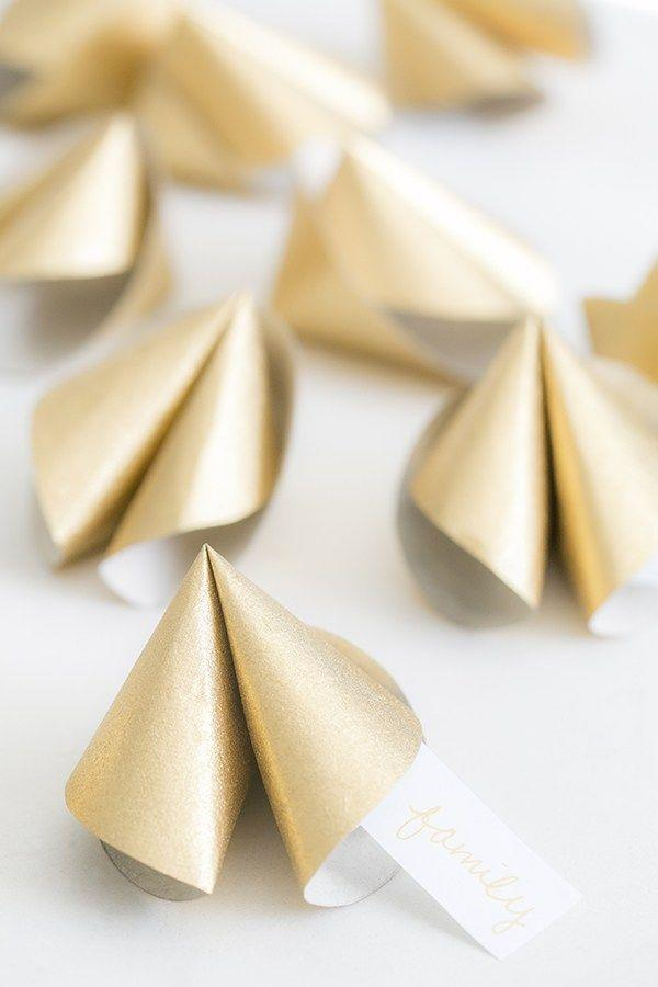 "<p>Ask friends and family members to offer their best life advice, write each one on a slip of paper, and stick them in these easy DIY fortune cookies for a thoughtful keepsake. </p><p><a href=""https://sugarandcharm.com/diy-paper-fortune-cookies"" rel=""nofollow noopener"" target=""_blank"" data-ylk=""slk:Get the tutorial."" class=""link rapid-noclick-resp"">Get the tutorial.</a></p><p><a class=""link rapid-noclick-resp"" href=""https://www.amazon.com/11-Cardstock-Invitations-Scrapbooking-81211-C-40-50/dp/B007GE1V88?tag=syn-yahoo-20&ascsubtag=%5Bartid%7C10063.g.36078412%5Bsrc%7Cyahoo-us"" rel=""nofollow noopener"" target=""_blank"" data-ylk=""slk:SHOP GOLD PAPER"">SHOP GOLD PAPER</a></p>"