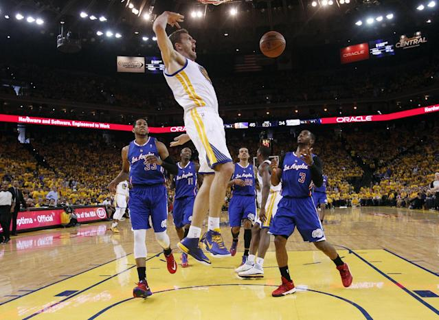Golden State Warriors' David Lee, center, dunks next to Los Angeles Clippers' Danny Granger (33), and Chris Paul (3) during the first half in Game 4 of an opening-round NBA basketball playoff series on Sunday, April 27, 2014, in Oakland, Calif. (AP Photo/Marcio Jose Sanchez)