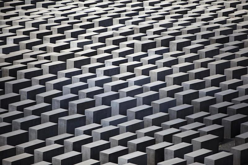 In this picture, taken June 17, 2011, the concrete slabs of the Holocaust Memorial in central Berlin are photographed . Berlin police say they are considering additional security for Germany's main Holocaust memorial after an online video appeared to show New Year's revelers urinated on the site last week. The YouTube video appears to show drunken partygoers relieving themselves and launching fireworks from among the 2,711 concrete blocks commemorating the 6 million Jews killed by the Nazis. The site in the heart of Berlin is close to the Brandenburg Gate where hundreds of thousands of people traditionally ring in the New Year. Police spokesman Thomas Neuendorf said Monday Jan. 6, 2014 that the site was specifically designed to be open to the public, but that a fence could be erected during big events. (AP Photo/Markus Schreiber,File)