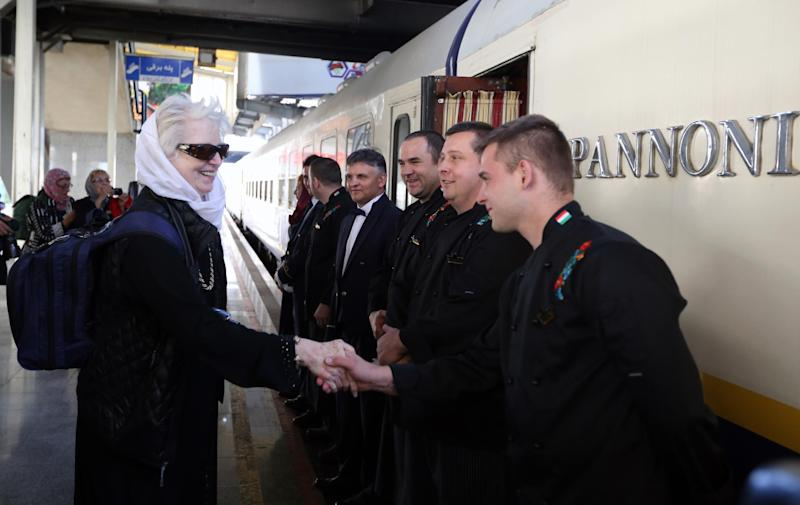 A tourist thanks the staff from a luxury train on the platform at a station in Tehran after arriving in the Iranian capital from Budapest on October 27, 2014 (AFP Photo/Atta Kenare)