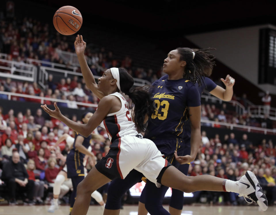 Stanford's Kiana Williams, left, lays up a shot past California guard Jaelyn Brown (33) during the first half of an NCAA college basketball game Friday, Jan. 10, 2020, in Stanford, Calif. (AP Photo/Ben Margot)