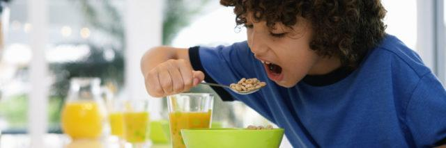 Boy at table eating cereal