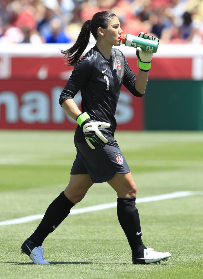 SANDY, UT - JUNE 30: Goalkeeper Hope Solo #1 of the USA takes a drink during a game against Canada during the second half of the women's Olympic send-off soccer match June 30, 2012 at Rio Tinto Stadium in Sandy, Utah.  The USA beat Canada 2-1.  (Photo by George Frey/Getty Images)