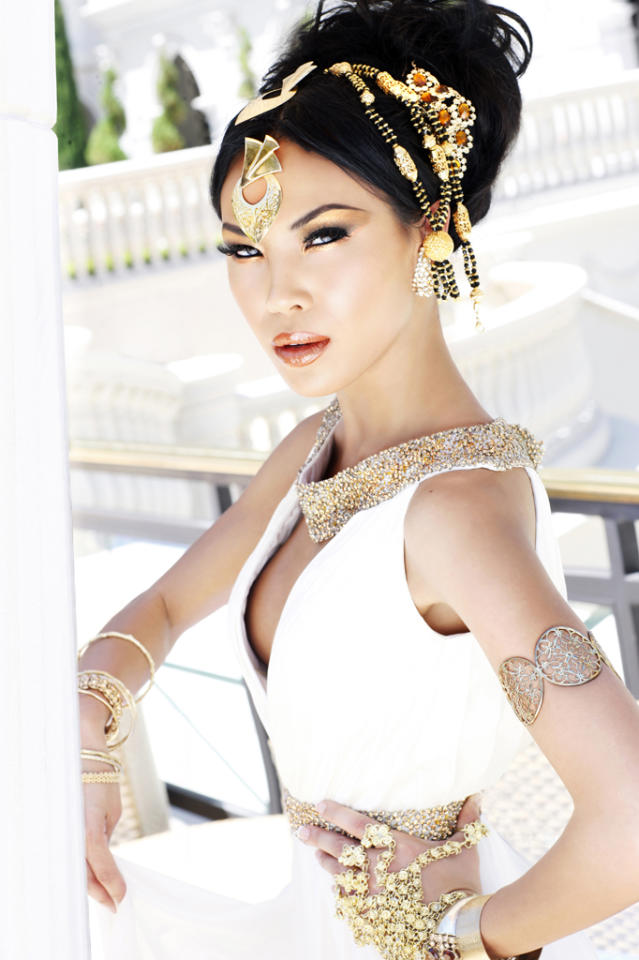 """Miss Minnesota USA 2012, Nitaya Panemalaythong, poses for fashion photographer Fadil Berisha at the """"Gardens of Goddess"""" photo shoot at Caesar's Palace Las Vegas Hotel & Casino pool. Tune in to NBC, June 3 at 9PM EST  for the live telecast of the 2012 Miss USA Competition to see who takes home the Diamond Nexus crown.  HO/Miss Universe Organization L.P., LLLP--RETOUCHED AND ALTERED FOR GLAMOR--"""