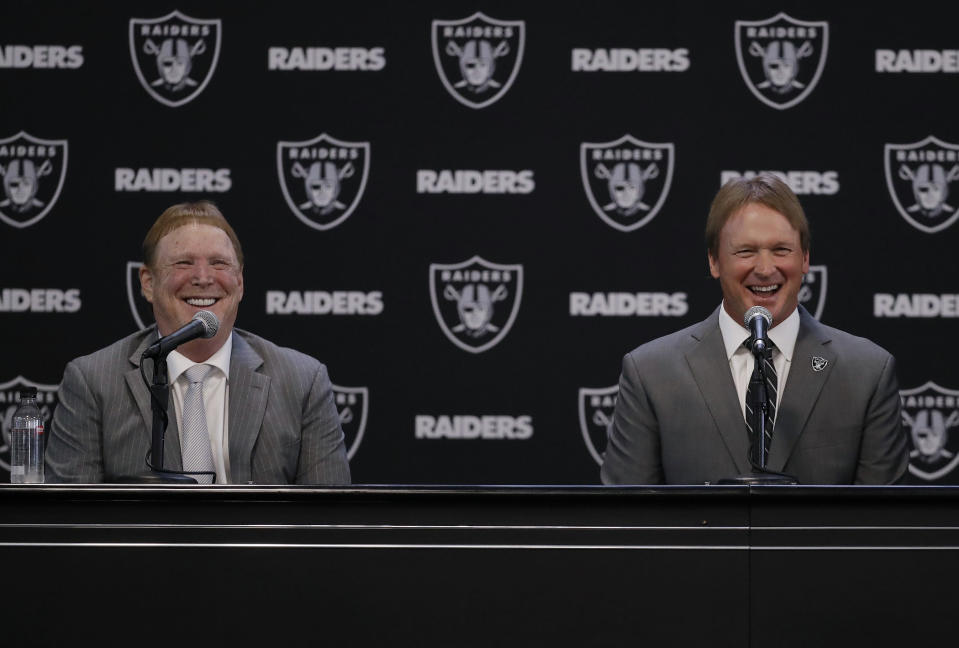 Oakland Raiders new head coach Jon Gruden, right, and Raiders owner Mark Davis appear together to announce Gruden's return to Oakland. (AP)