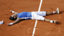 FILE - In this June 11, 2006, file photo, Spain's Rafael Nadal lays on the court after defeating Switzerland's Roger Federer in the men's final match of the the French Open tennis tournament at Roland Garros stadium in Paris. oger Federer tells The Associated Press that he figures Rafael Nadal and Novak Djokovic both will surpass his men's record for Grand Slam titles. (AP Photo/Capucine Bailly/Pool, File)
