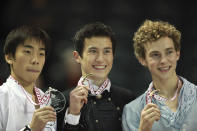 <p>Rippon (right) poses with his bronze medal alongside Patrick Chan of Canada (center) and Nobunari Oda of Japan (left) the silver medalist at Skate Canada International.<br>(Photo by Geoff Robbins/AFP/Getty Images) </p>