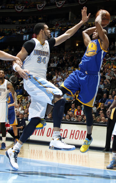 Golden State Warriors guard Jarret Jack, right, shoots as Denver Nuggets forward JaVale McGee defends during the first quarter of Game 5 of their first-round NBA basketball playoff series, Tuesday, April 30, 2013, in Denver. (AP Photo/David Zalubowski)