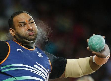 Inderjeet Singh of India competes in the men's shot put final during the 15th IAAF World Championships at the National Stadium in Beijing