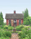 """<p>This backyard studio is the ultimate creative retreat for one Minnesota artist and her daughter. It's complemented by a stunning English garden and a coat of red, barn-style paint.</p><p><a class=""""link rapid-noclick-resp"""" href=""""https://www.amazon.com/Tiny-House-Live-Small-Dream/dp/0525576614?tag=syn-yahoo-20&ascsubtag=%5Bartid%7C10050.g.1887%5Bsrc%7Cyahoo-us"""" rel=""""nofollow noopener"""" target=""""_blank"""" data-ylk=""""slk:SHOP TINY HOUSE COFFEE TABLE BOOKS"""">SHOP TINY HOUSE COFFEE TABLE BOOKS</a></p>"""
