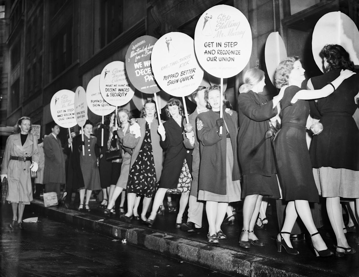 Employees of the Arthur Murray Dance Studios picket in a conga line before the dance studio offices today, May 7 in protest against Murray's alleged refusal to recognize Local 16, United Office and Professional Workers of America, CIO in New York on May 7, 1947.