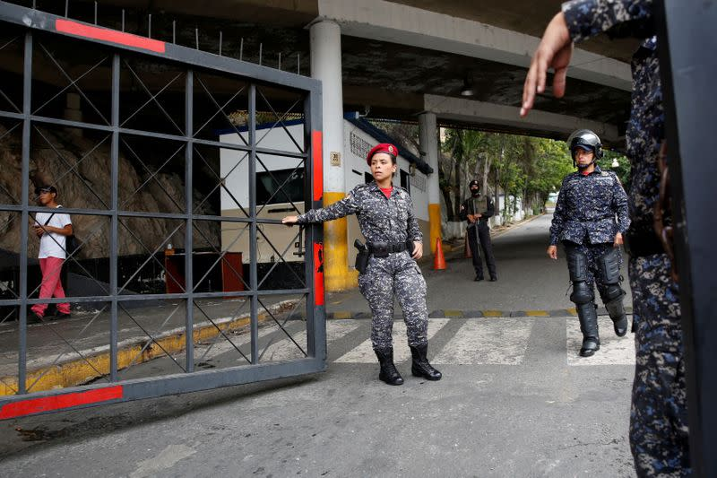 FILE PHOTO: Police officers stand guard at the entrance of a detention centre of the Bolivarian National Intelligence Service (SEBIN) in Caracas