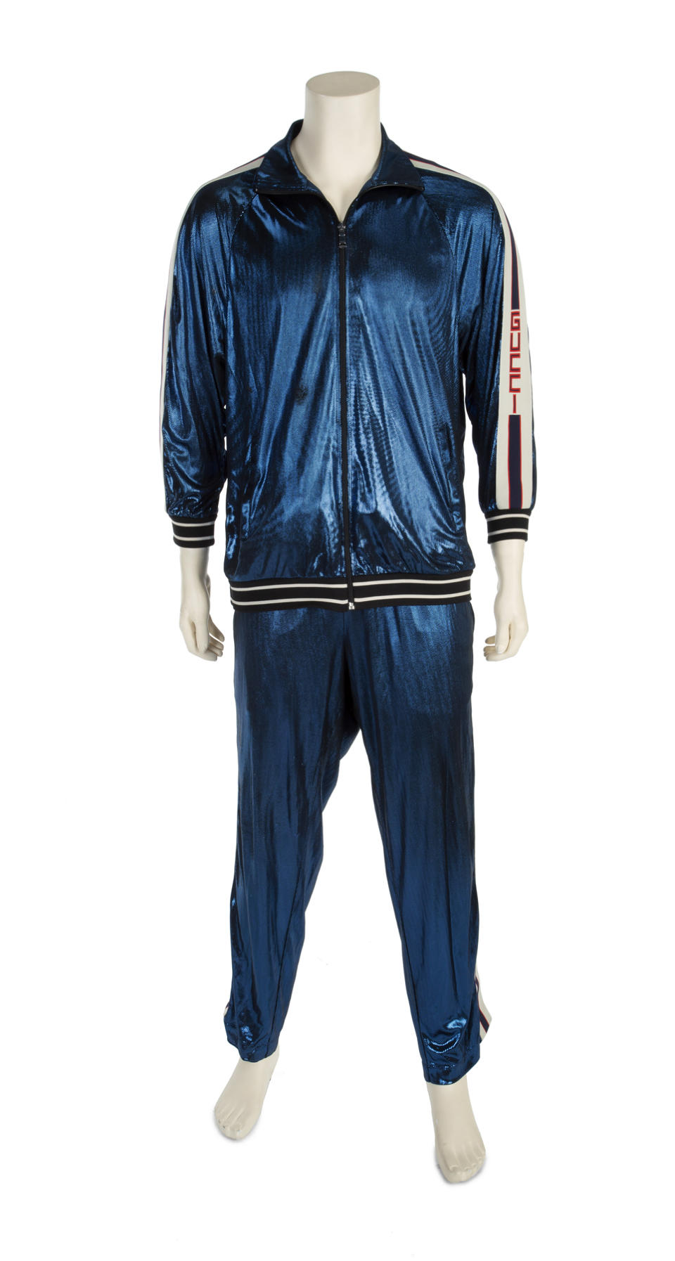A Gucci tracksuit once belonging to Sir Elton John is going under the hammer (Julien's Auctions/PA)