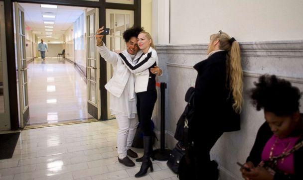 PHOTO: Bill Cosby accusers Lili Bernard and Caroline Heldman pose for a selfie while waiting in line before the courtroom opens at the Montgomery County Courthouse in Norristown, Pa., April 26, 2018. (Mark Makela/Pool via Getty Images)